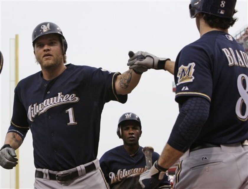 Milwaukee Brewers' Corey Hart, left, is congratulated by Ryan Braun, right, after he hit a three-run home run off Cincinnati Reds starting pitcher Chad Reineke in the third inning of a baseball game, Tuesday, May 31, 2011, in Cincinnati. (AP Photo/Al Behrman)