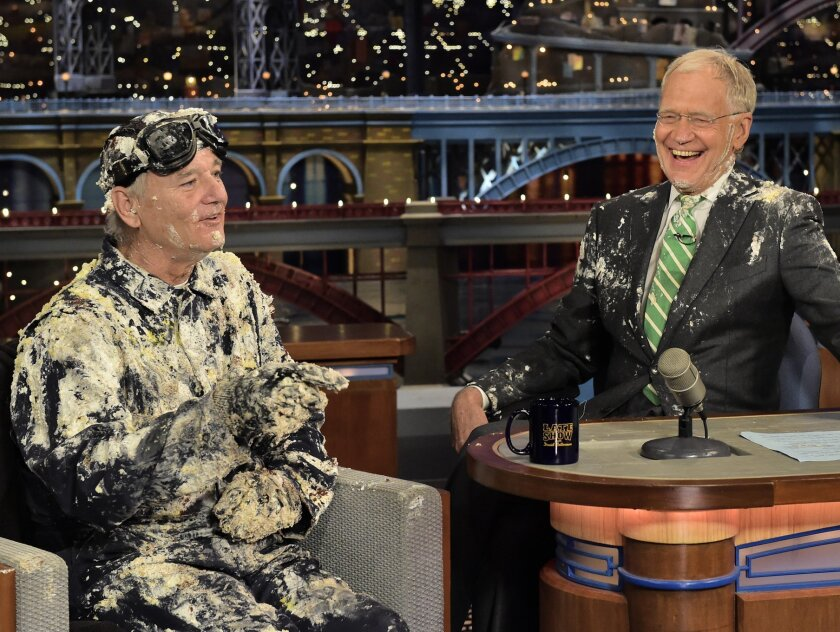 "In this photo provided by CBS, actor Bill Murray, left, talks with host David Letterman after emerging from a cake to say good-bye, Tuesday, May 19, 2015, on the set of the ""Late Show with David Letterman,"" in New York. Letterman's final show airs Wednesday, May 20. (John Paul Filo/CBS via AP) MANDATORY CREDIT; NO ARCHIVE; NO SALES; NORTH AMERICAN USE ONLY"