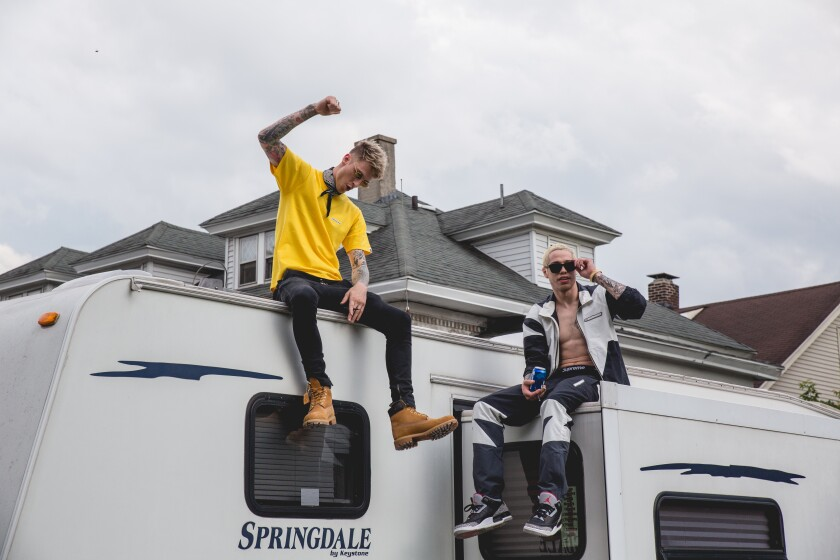 Machine Gun Kelly and Pete Davidson atop an RV in the movie 'Big Time Adolescence'