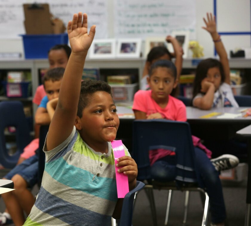 At Heritage Elementary School, where 83.4 percent of student met or exceeded standard in English Language Arts, Ricky Spitler raises his hand to answer the teacher's questions about the similarities in each group's interpretation of what was read to the class. Student assessment scores at Chula Vista Elementary School District surpassed those of both its county and state counterparts again this academic year.