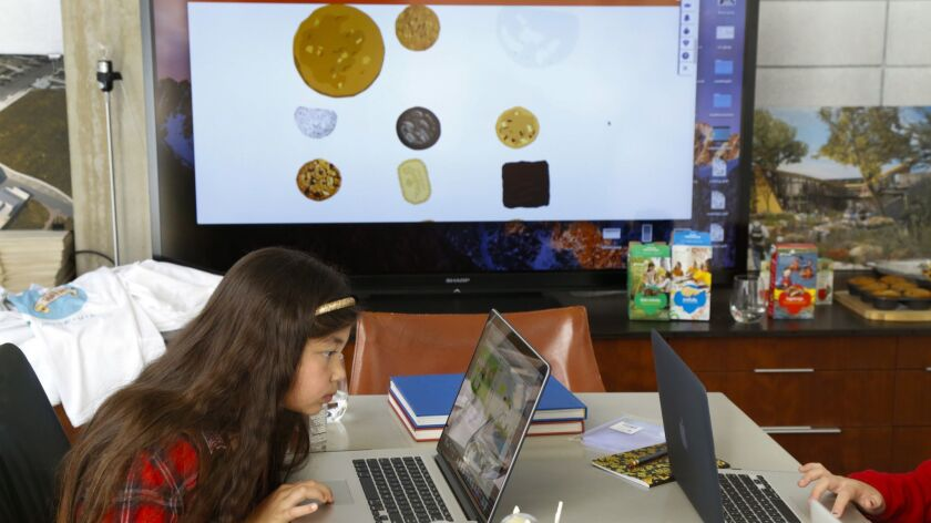 """In the 2017 file photo, 8-year-old Olivia Manning participates in a Girls Scouts San Diego computer-coding session to build the """"Marshmallow Run"""" online game. Girl Scouts USA recently unveiled 30 new badges, many of them dedicated to science and technology."""