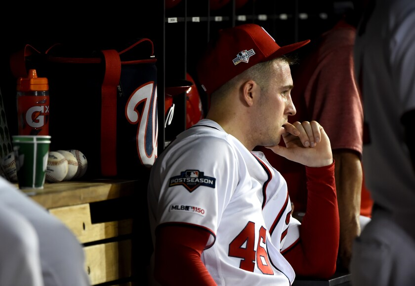 Washington Nationals pitcher Patrick Corbin watches from the dugout.