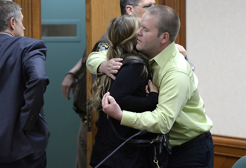 Jordan Byelich, right, husband of bicyclist Jill Byelich, hugs Mitzi Nelson after her sentencing Wednesday. Nelson was distracted by her cellphone when she struck and killed Jill Byelich.