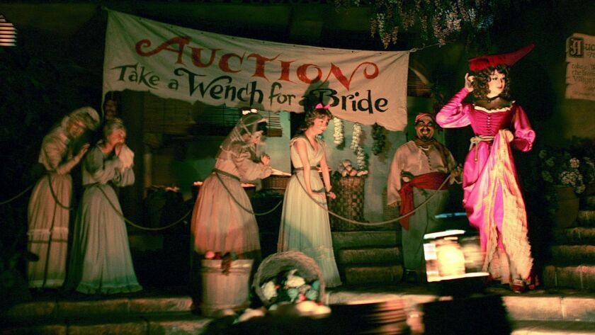 Women on the auction block in Disney's Pirates of the Caribbean attraction.