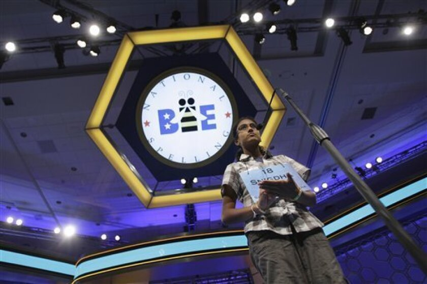 Snigdha Nandipati, 13, from San Diego, Calif., spells out her word on her hand as she concentrates during round two of the National Spelling Bee, Wednesday, June 1, 2011, in National Harbor, Md. (AP Photo/Jacquelyn Martin)