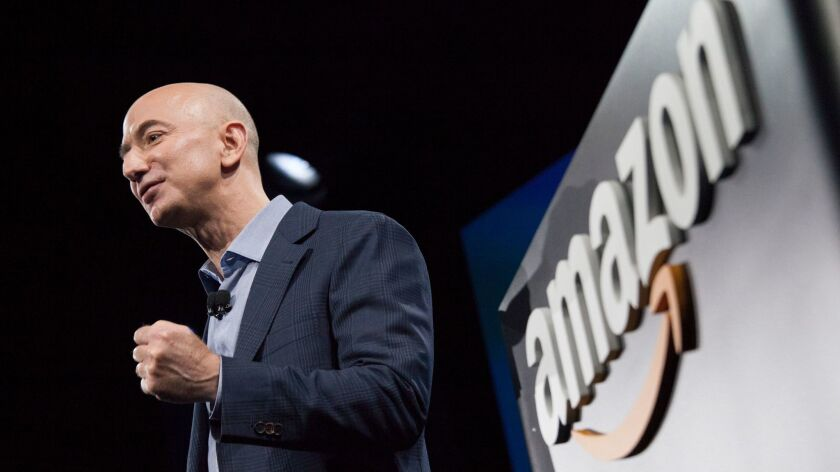 SEATTLE, WA - JUNE 18: Amazon.com founder and CEO Jeff Bezos presents the company's first smartphone