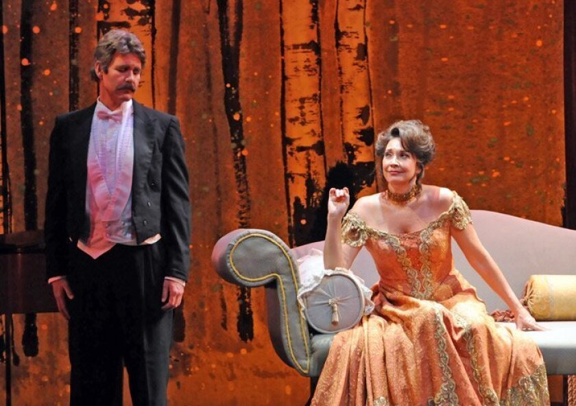 "Scott Gregory as Fredrik Egerman and Andrea Huber as Désirée Armfeldt in Lyric Opera's ""A Little Night Music."""