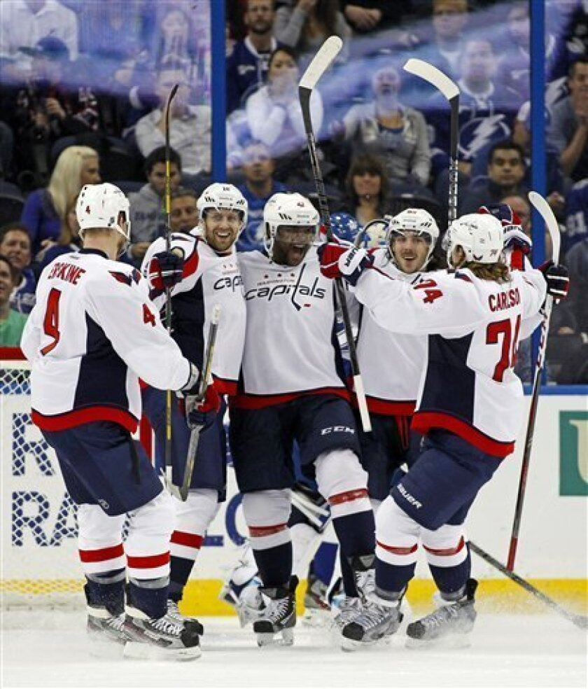 Members of the Washington Capitals, from left, John Erskinem, Eric Fehr, Joel Ward, Mathieu Perreault and John Carlson celebrate a goal against the Tampa Bay Lightning during the second period of an NHL hockey game on Thursday, Feb. 14, 2013, in Tampa, Fla. (AP Photo/Mike Carlson)