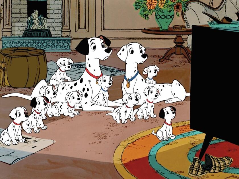"Pongo and Perdita with puppies in the movie ""101 Dalmatians."""