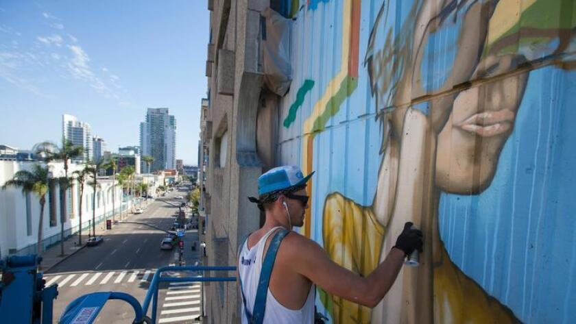 Christopher Konecki working on his 707 Broadway mural. (/ Courtesy photo)