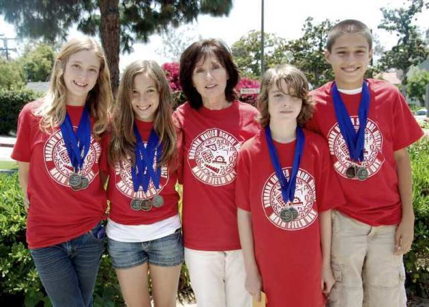 Community: School math teams multiply their medals