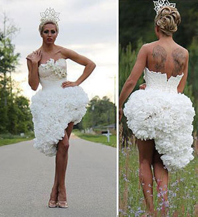 Mimoza Haska's winning gown in the ninth annual toilet paper wedding dress contest features a cutaway bustier and high-low skirt.