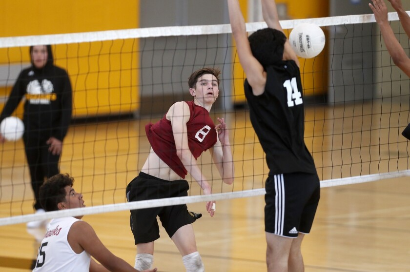 Ocean View High's Jackson Petrovich (8) scores against Godinez during the first set in a Golden West