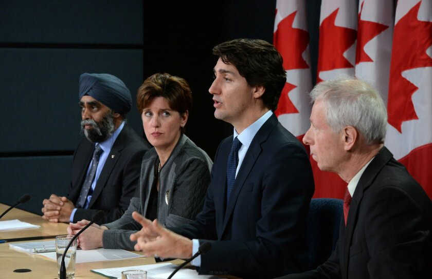Canada Prime Minister Justin Trudeau answers a question as he is joined by Minister of National Defense Harjit Sajjan, left to right, Minister of International Development and La Francophonie Marie-Claude Bibeau and Minister of Foreign Affairs Stephane Dion during a news conference at the National
