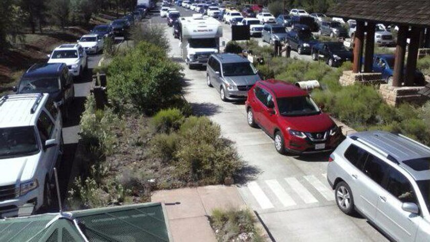 Cars line up to enter the south entrance of Grand Canyon National Park in August 2017