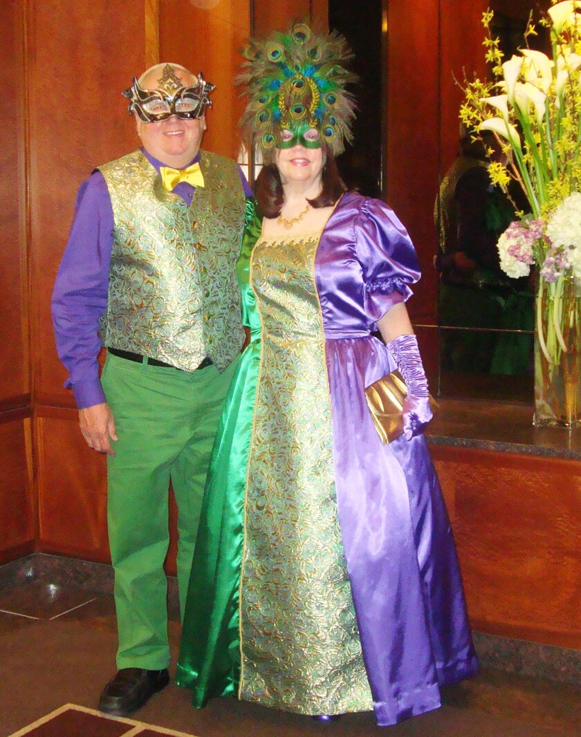 Mike Davis and Susan Casey Davis in mardi gras-themed costumes they made.