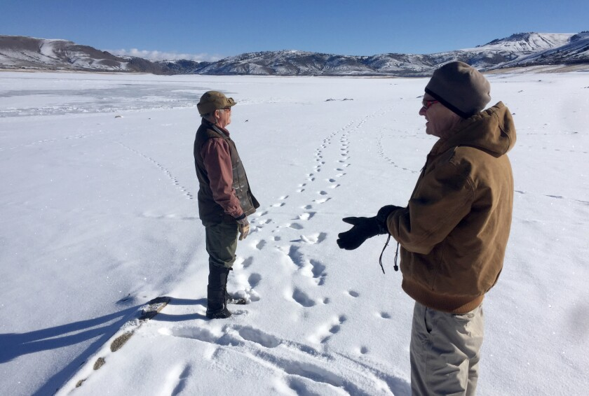 David Primus, who studies the history of the Gunnison Valley, right, and Bob Robbins look for remnants of Iola, flooded in the early 1960s to make way for Blue Mesa Reservoir, the largest body of water in Colorado.