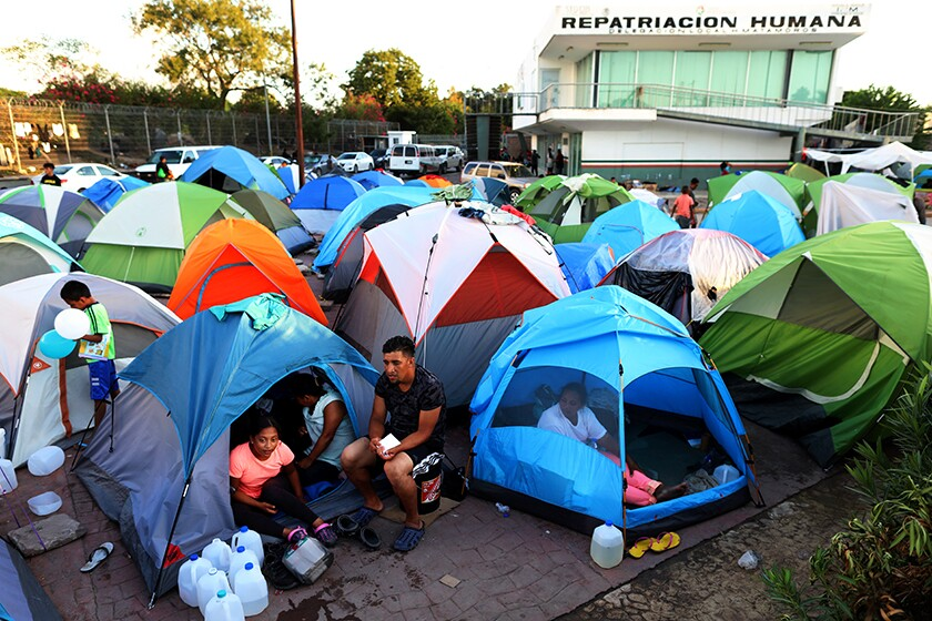 Several tents crowded in an encampment in Mexico near the U.S. border.