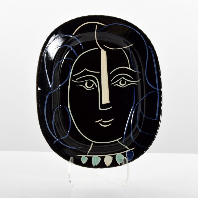The large plate by Pablo Picasso featuring the face of a woman sold for $25,000 early this month at Palm Beach Modern Auctions.