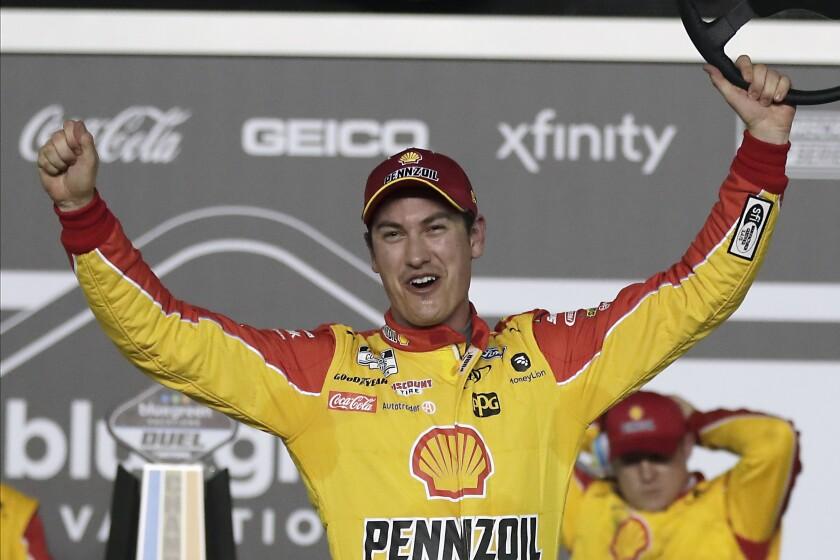 Joey Logano celebrates in Victory Lane after winning the first of two NASCAR Daytona 500 qualifying auto races at Daytona International Speedway on Thursday in Daytona Beach, Fla.