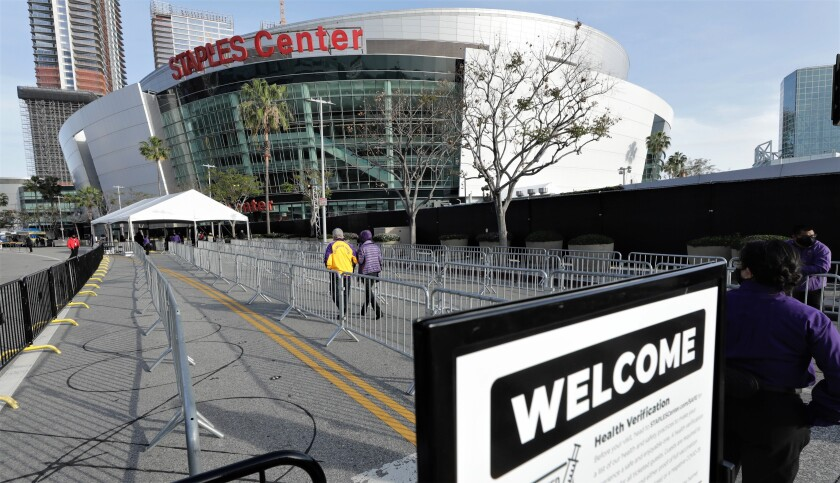 A slow trickle of fans head toward the Staples Center entrance for the Lakers-Celtics game.