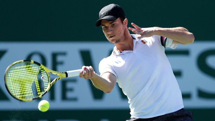 Miomir Kecmanovic returns against Yoshihito Nishioka during the BNP Paribas Open tennis tournament at Indian Wells on Wednesday.