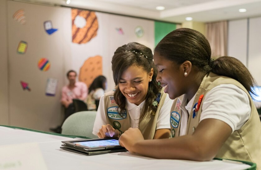 In this undated photo released by Girl Scouts of the USAGirl Scouts, Bria and Shirell practice selling cookies on one of two new digital platforms. It's the first time Girls Scouts of the USA has allowed sale of cookies using a mobile app and personalized websites. The Digital Cookie program is intended to enhance, not replace, traditional use of paper spreadsheets. (AP Photo/Girl Scouts of the USA)
