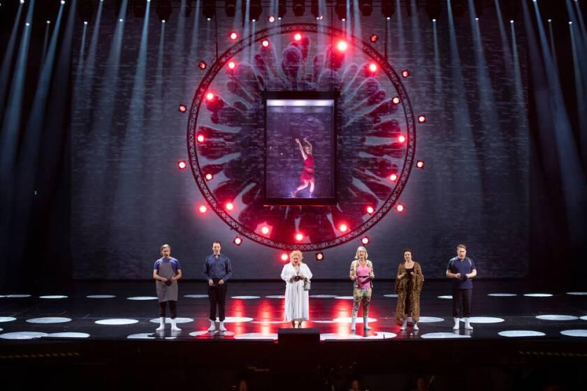 "Karita Mattila, center, in a scene from Finnish National Opera's ""Covid fan Tutte"""