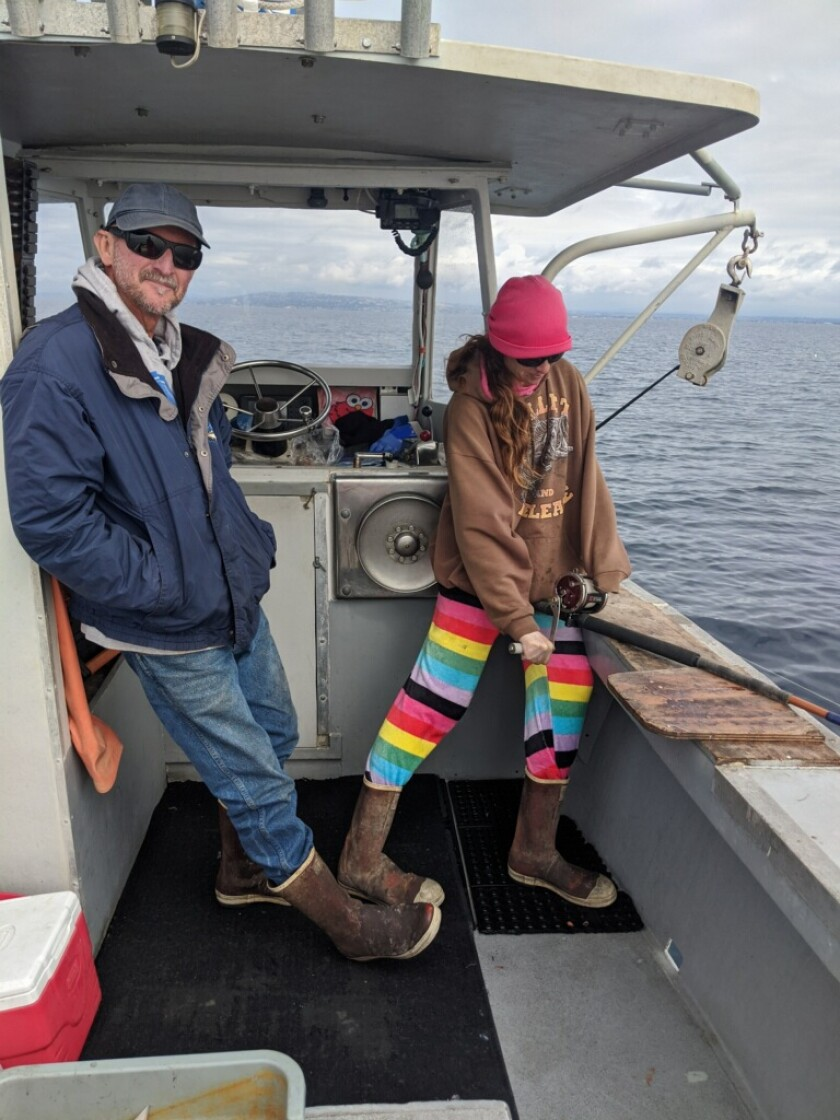 Local fisherman John Law, pictured with deckhand Victoria Minnich, says he opposes the location of a proposed fish farm.
