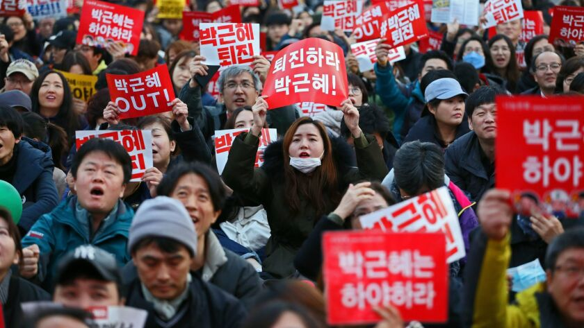 Protesters call for South Korean President Park Geun-hye to step down in Seoul on Saturday.