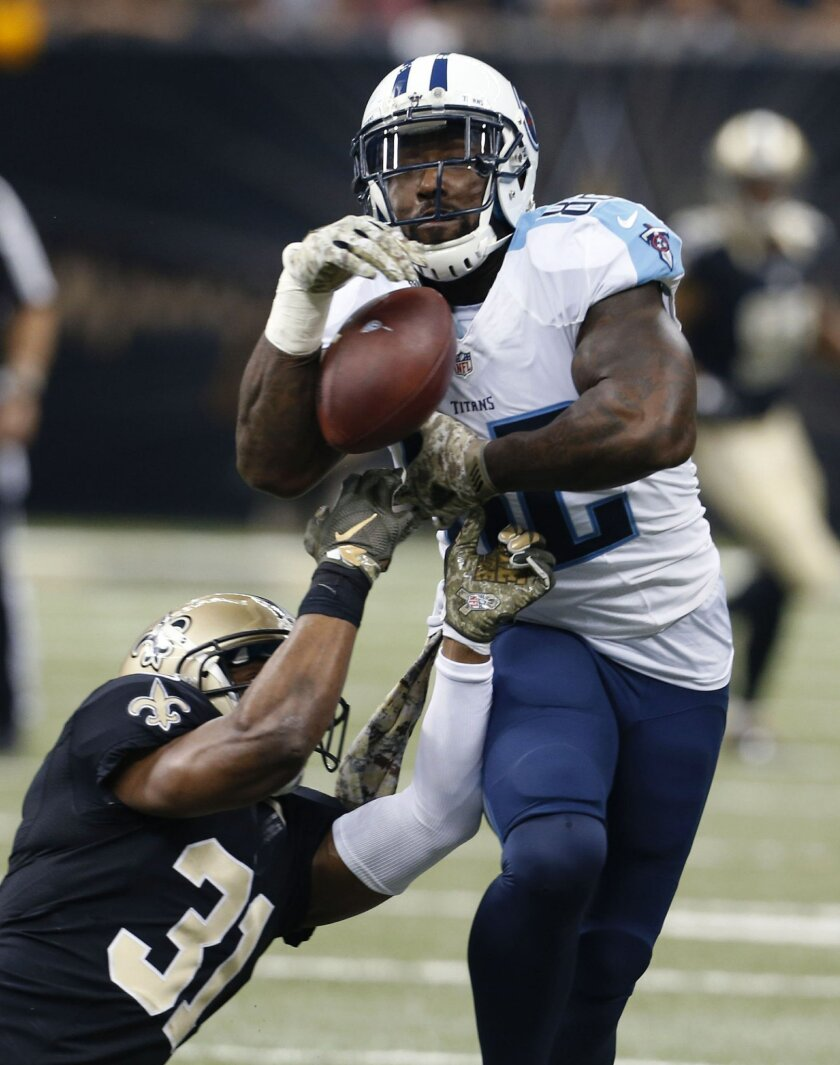 Tennessee Titans tight end Delanie Walker (82) pulls the ball out of the hands of New Orleans Saints free safety Jairus Byrd (31) on a touchdown reception in the first half of an NFL football game in New Orleans, Sunday, Nov. 8, 2015. (AP Photo/Jonathan Bachman)