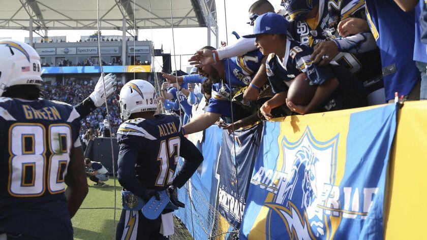 Chargers wide receiver Keenan Allen (13) wears a belt from a fan in celebration of a touchdown.