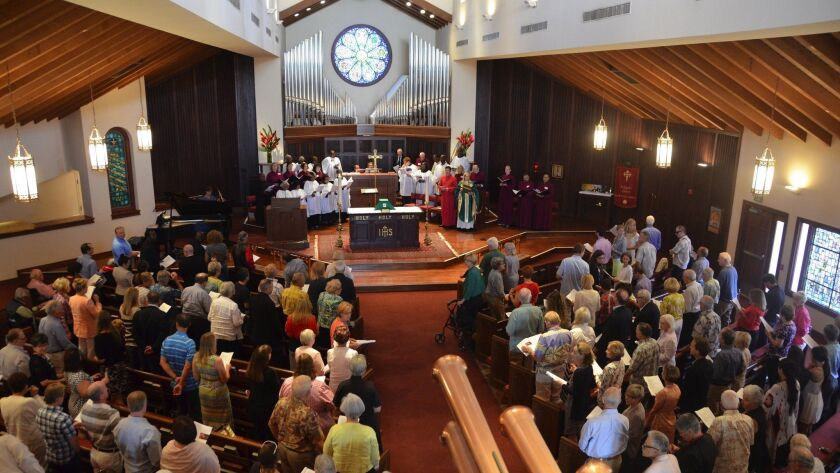 The congregation at St. James The Great Episcopal Church gathers for the last time in its curent loc