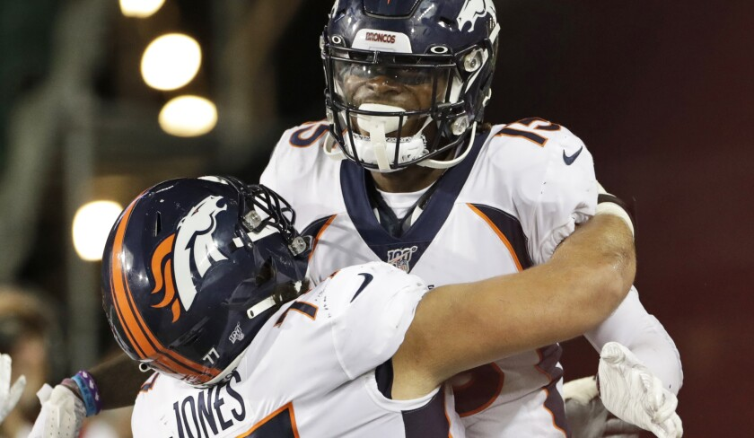 Denver Broncos wide receiver Juwann Winfree (15) celebrates a touchdown with offensive guard Sam Jones (77) during the second half of the team's Football Hall of Fame preseason game against the Atlanta Falcons on Thursday in Canton, Ohio.