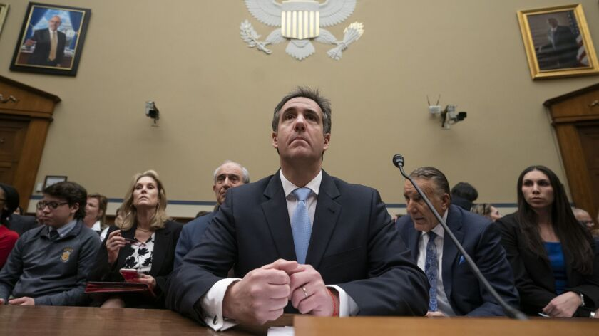 Michael Cohen finishes a day of testimony on Capitol Hill in Washington on Feb. 27.