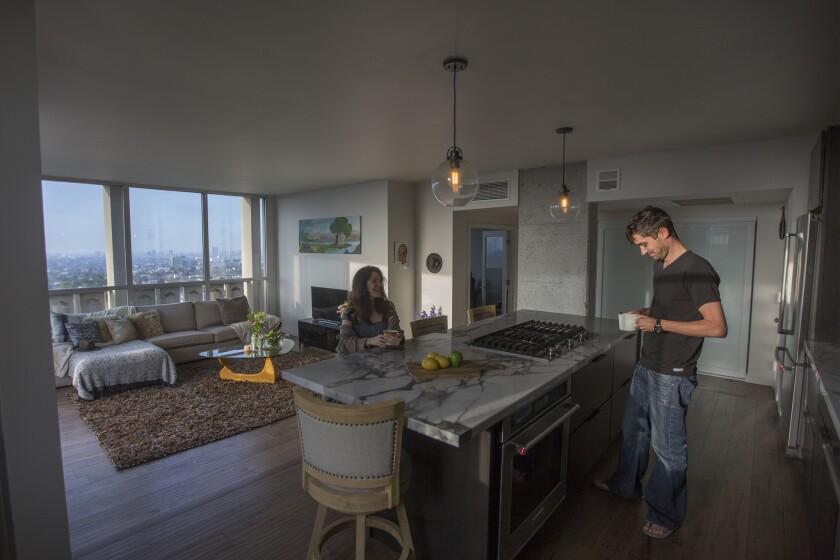 Actress Aleksa Palladino and cinematographer Needham Smith III are seen at home in their 1960s condominium.
