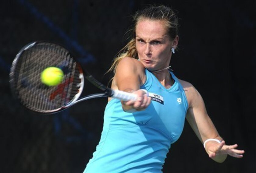 Magdalena Rybarikova, of Slovakia, returns a volley to Jana Cepelova, of Slovakia, at the Citi Open tennis tournament, Thursday, Aug. 2, 2012, in Washington. Rybarikova defeated Cepelova 6-2, 6-4. (AP Photo/Richard Lipski)
