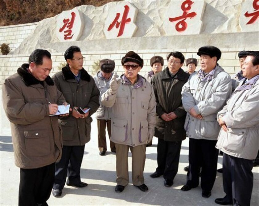 In this undated photo released by (north) Korean Central News Agency via Tokyo-based Korea News Service on Sunday February 1, 2009, North Korean leader Kim Jong Il, center, pays a visit to the Ryesonggang Youth Power Station No. 1 plant in North Hwanghae province, North Korea. (AP Photo/Korean Central News Agency via Korea News Service)