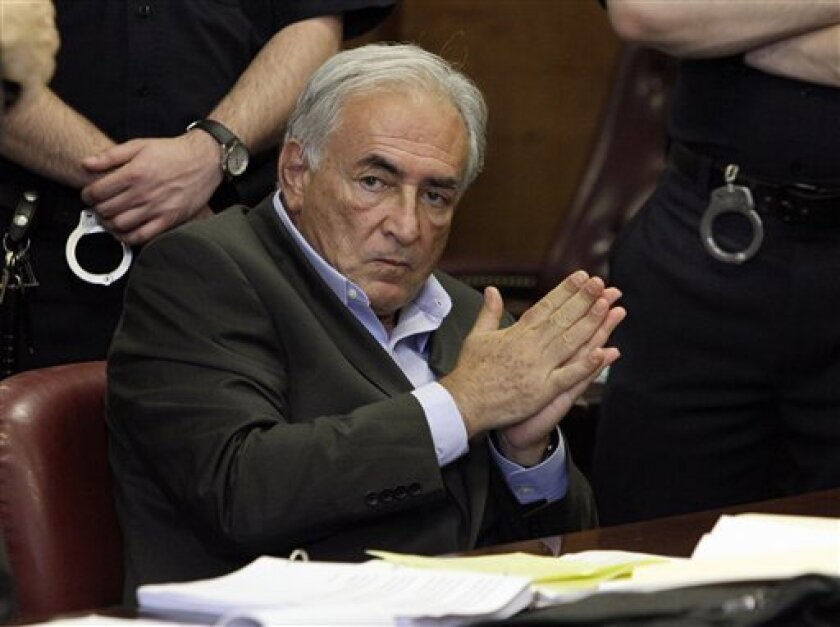 CORRECTS COURT DAY TO MONDAY AND ADDS DATE--FILE - In this May 19, 2011 file photo, former International Monetary Fund leader Dominique Strauss-Kahn listens to proceedings in his case in New York state Supreme Court. Strauss-Kahn is due to answer the charges in court in New York Monday June 6, 2011 that he assaulted a hotel maid. (AP Photo/Richard Drew, File)