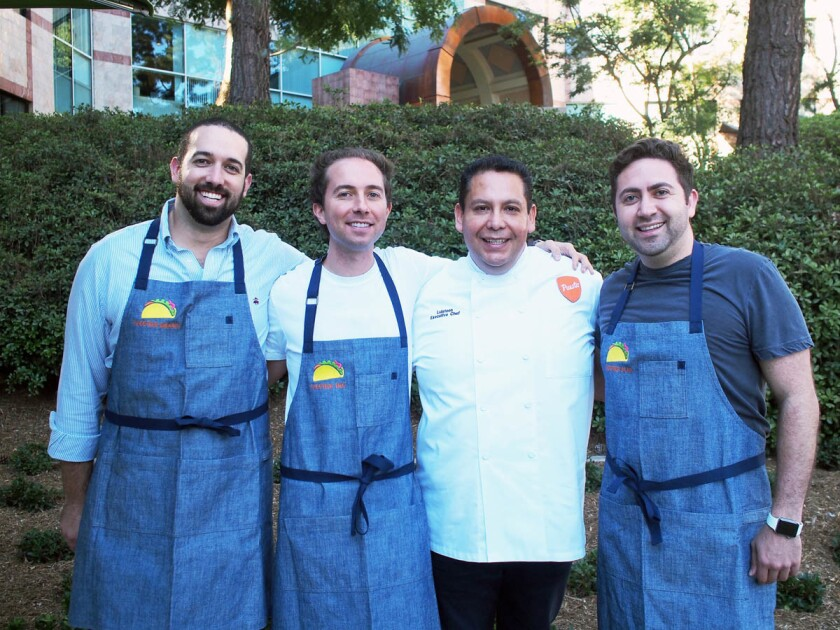 Puesto Executive Chef Luisteen Gonzalez, center in white chef's jacket, was born and raised in Mexico City. (Courtesy photo)