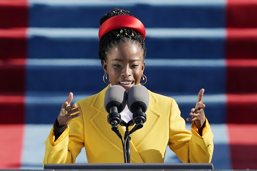 Amanda Gorman gestures to emphasizes a line as she recites her poem at President Biden's inauguration