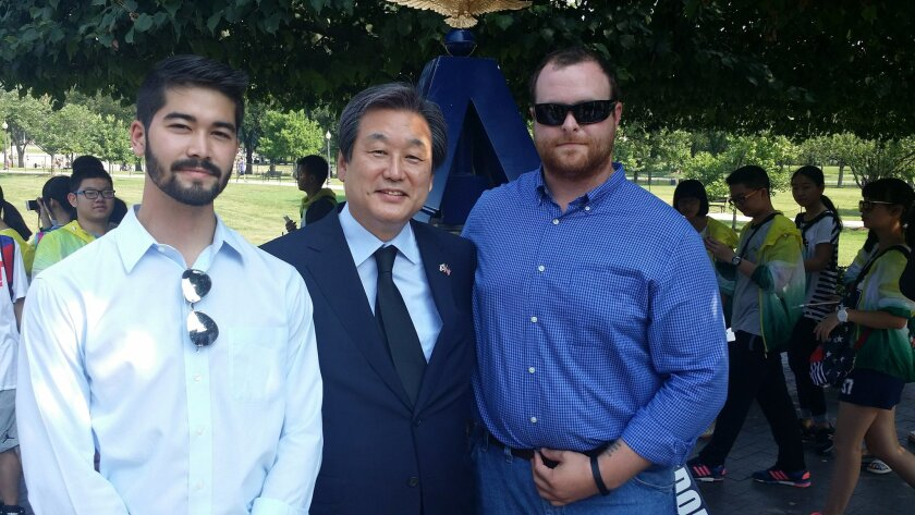 Daniel Rakers of the foundation, Rep. Kim Moo-sung of South Korea and Kaleb Weakley of the foundation. Courtesy photo