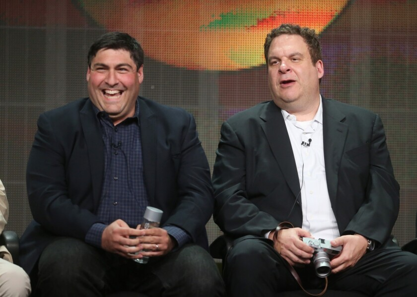 """Adam F. Goldberg, left, and actor Jeff Garlin speak during the """"The Goldbergs"""" panel at the Beverly Hilton hotel in Beverly Hills."""