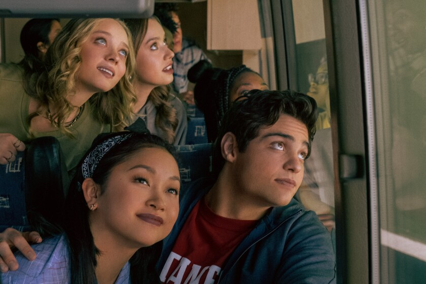 """Lana Condor, left foreground, and Noah Centineo on the bus in """"To All the Boys: Always and Forever."""""""