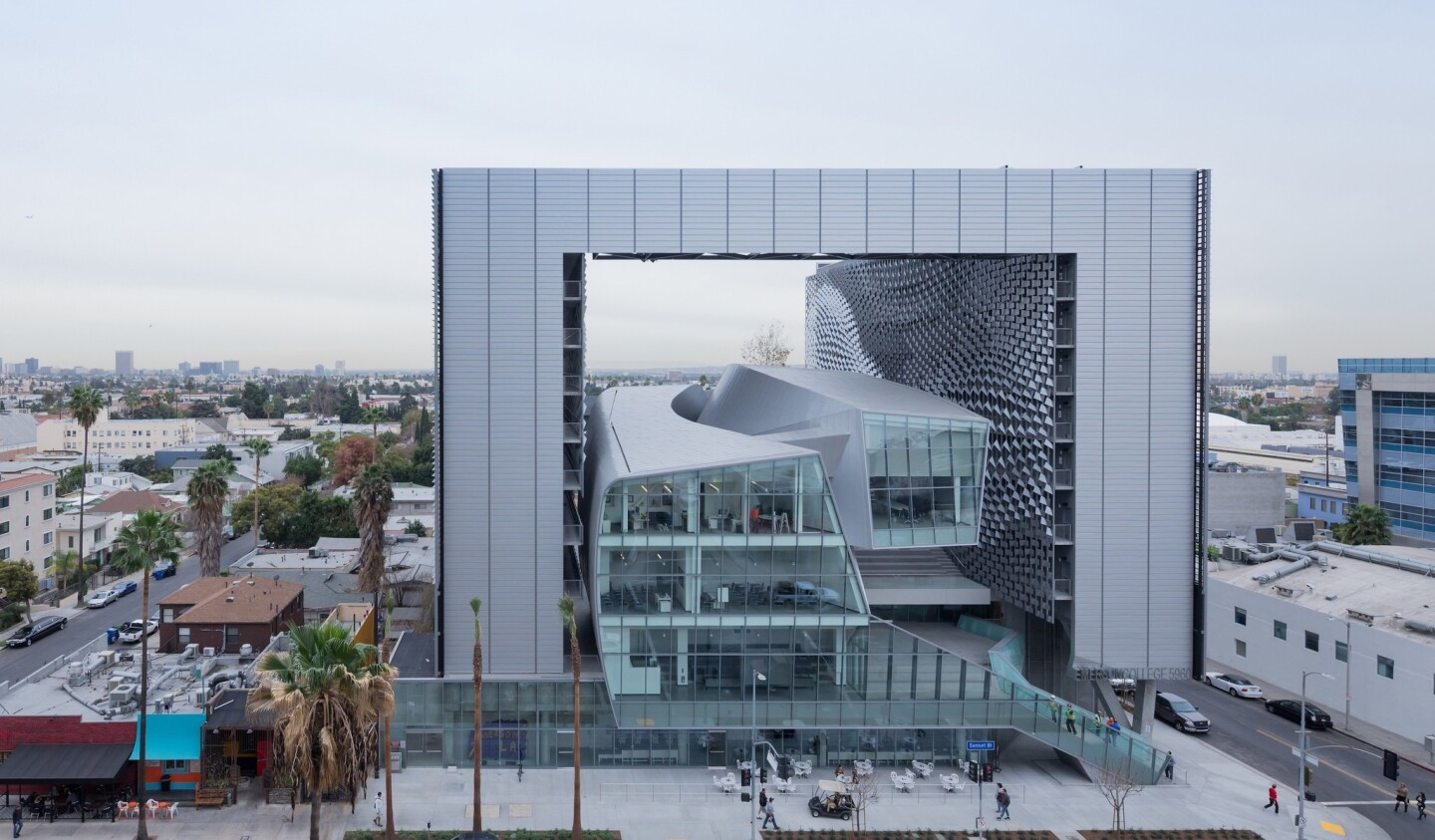Wrapped in metal and glass, the Emerson College building designed by Thom Mayne and Morphosis ingeniously incorporates the look of a boxy Hollywood stage set.