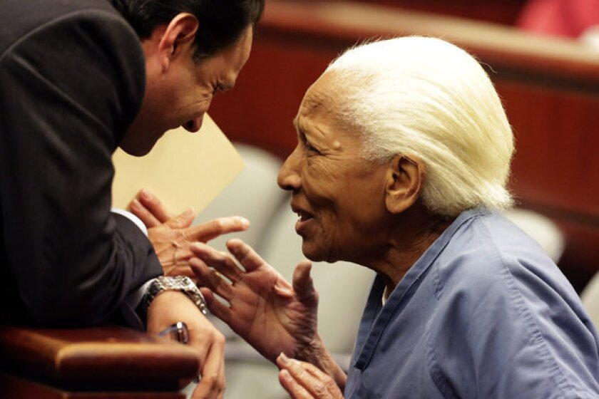 Doris Marie Payne, 83, talks to her attorney at her arraignment in Indio at a November hearing. Payne, a convicted jewel thief, has pleaded not guilty.