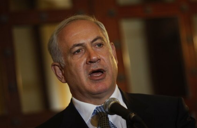 Israel's Likud Party leader Benjamin Netanyahu speaks to reporters during a meeting with journalists from the Foreign Press Association at the King David hotel in Jerusalem, Tuesday, Jan. 13, 2009.  (AP Photo/Dan Balilty)