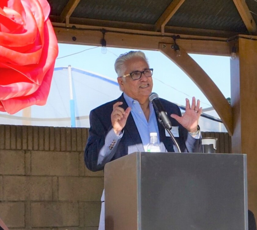 Paul Leon, CEO of the Illumination Foundation, speaks during the dedication of the Bob Murphy House, an eight bedroom, 3,224-foot eight home in Anaheim that is among three emergency shelters for families operated by the nonprofit.