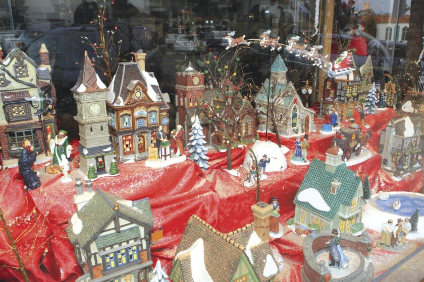 La Jolla Village Merchants Association is asking businesses in the Village to take part in its 'Festival of Lights' contest. No need for encouragement, Bowers Jewelers at 7860 Girard Ave. has been setting up an elaborate Dickens Village in its storefront windows for numerous years each holiday seas