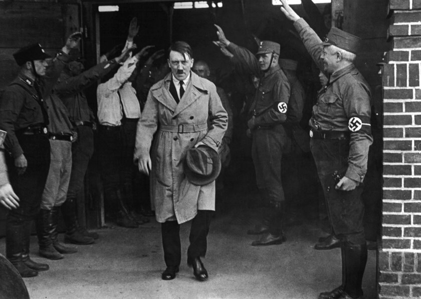 CORRECTS YEAR PHOTO WAS TAKEN IN TO 1931 INSTEAD OF 2013- FILE - In this Dec. 5, 1931 file photo Adolf Hitler, leader of the National Socialists, emerges from the party's Munich headquarters. Historical documents show Adolf Hitler enjoyed special treatment, including plentiful supplies of beer, dur